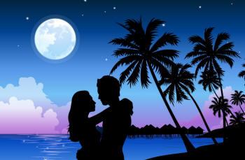 Влюбленные на закате на берегу моря